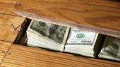 НБУ: Украинцы держат «под матрасами» около $70 млрд.