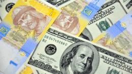 Гривня второй день подряд ощутимо девальвирует на межбанке | Валюта | Дело