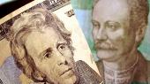Курс доллара опустился ниже 25 грн/$